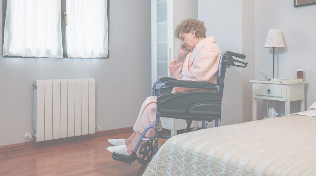 senior patient upset in wheelchair