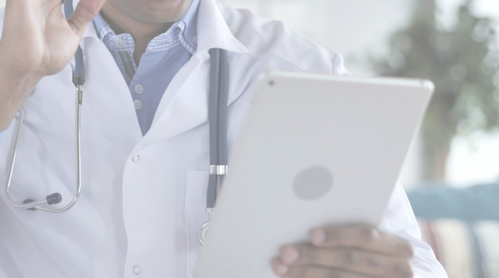 Clinician Holding Tablet