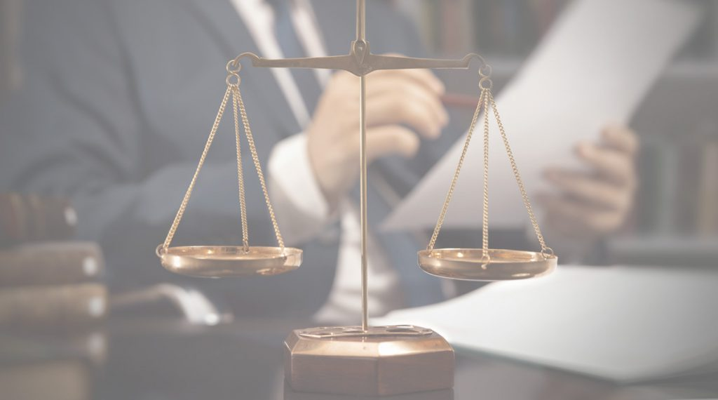 a scale resting on a law office desk