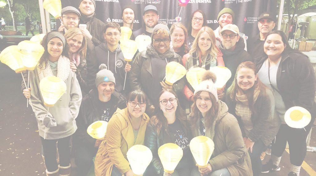 Providertrust Team holding lanterns.
