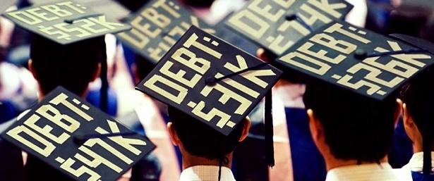 "a group of graduates whose graduation caps read ""debt, yikes!"""