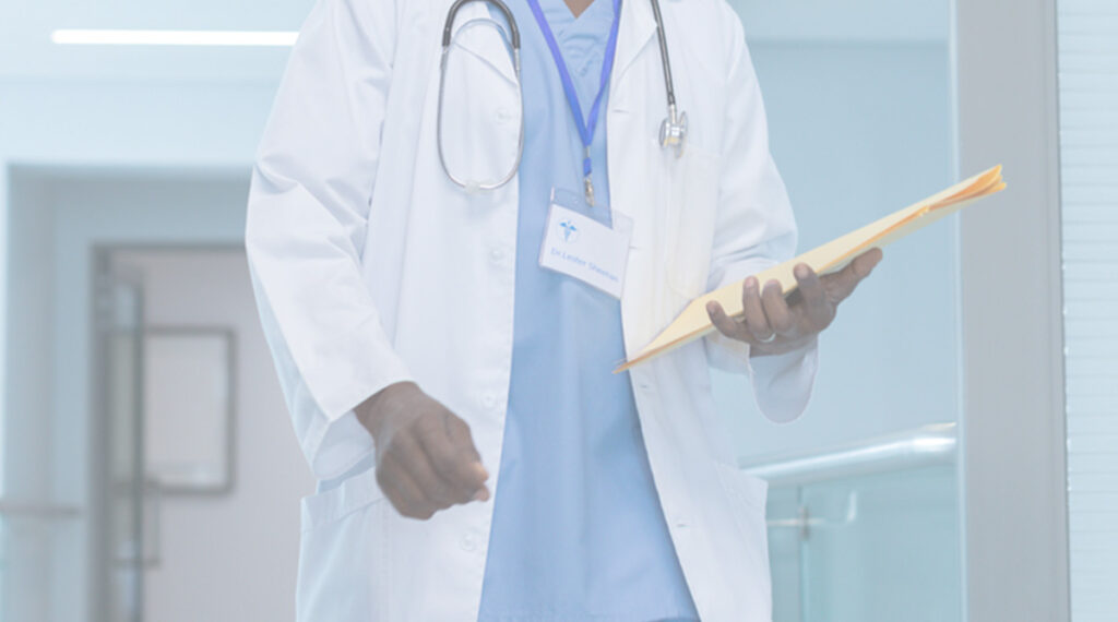 clinician wearing lab coat with files