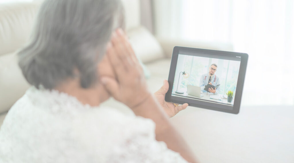 woman on telehealth call with doctor