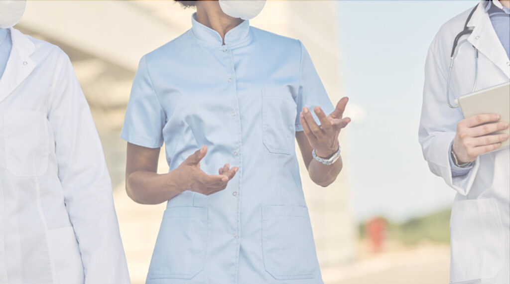 close up of three doctors wearing PPE